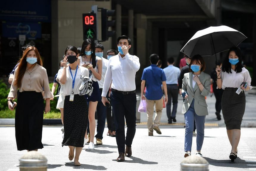 The office crowd in masks at Raffles Place during lunch hour on June 15, 2020.