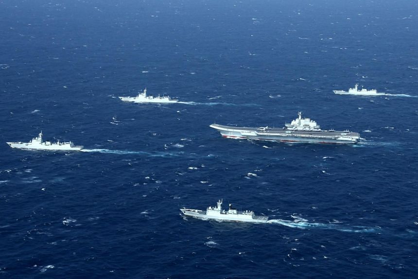 A Chinese Navy formation, including the aircraft carrier Liaoning (centre), during military drills in the South China Sea on Jan 2, 2017.