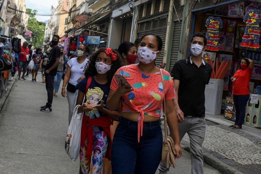 People walk along a popular shopping street in Rio de Janeiro, in June 2020.