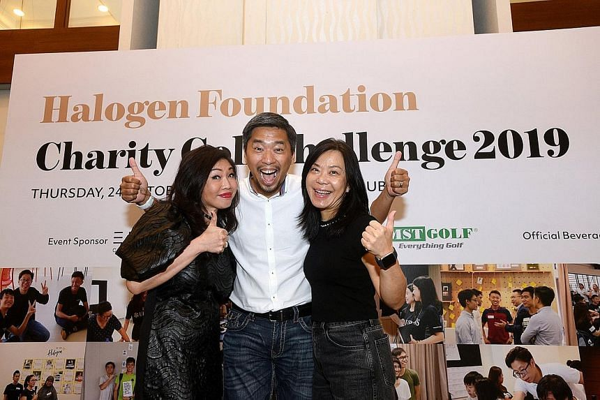 Dr Tan (right), with Halogen Foundation founder Martin Tan and fund raising co-chair Jessie Ho-Thong at a Halogen charity event last year.