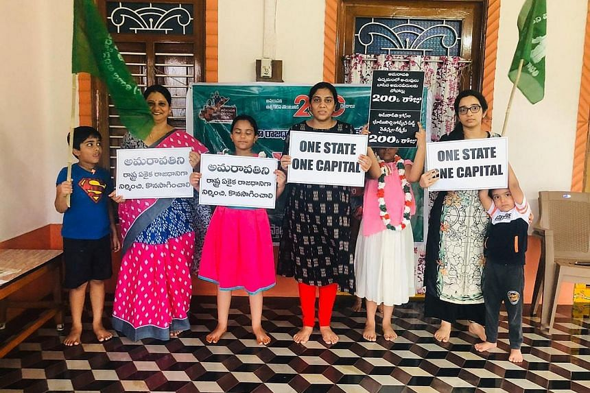 Farmer Chalapati Rao's family, who gave 30ha towards building the new capital city of Amaravati in the southern Indian state of Andhra Pradesh, protesting against the government's decision to cancel the project. Thousands of farmers contributed their