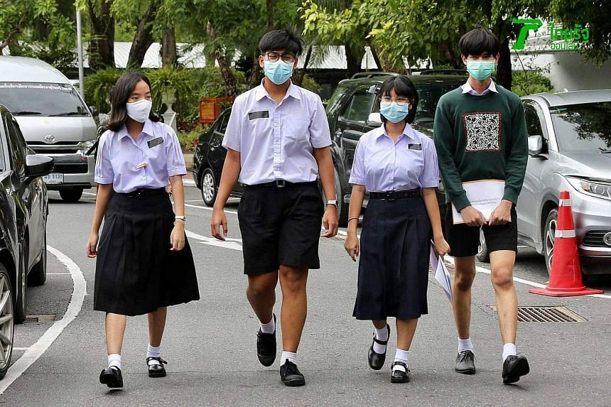 Schoolgirl Benjamaporn Nivas, 15, (second from right) with three of her student colleagues. They run Bad Student, which has amassed 25,000 followers on Twitter and some 1,700 members in a Line chat group over the three months of its existence.