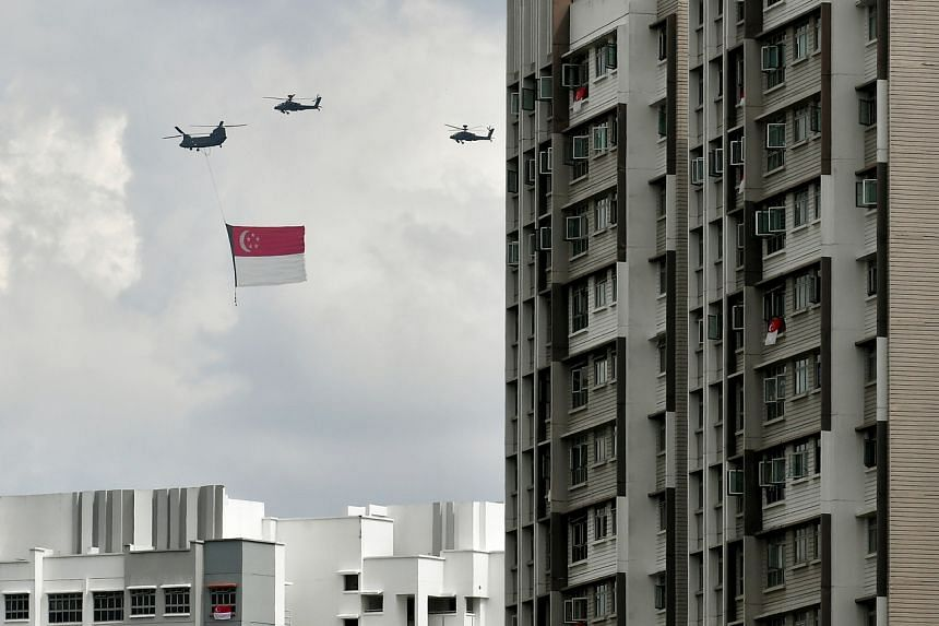State flag flypast above flats along Sengkang East Way during National Day Parade Rehearsal on July 26, 2020.