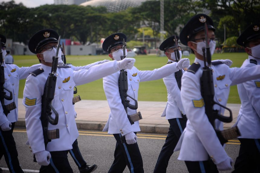 The marching contingent from the Singapore Air Force marches during the National Day Parade rehearsal at the Padang on July 26, 2020.