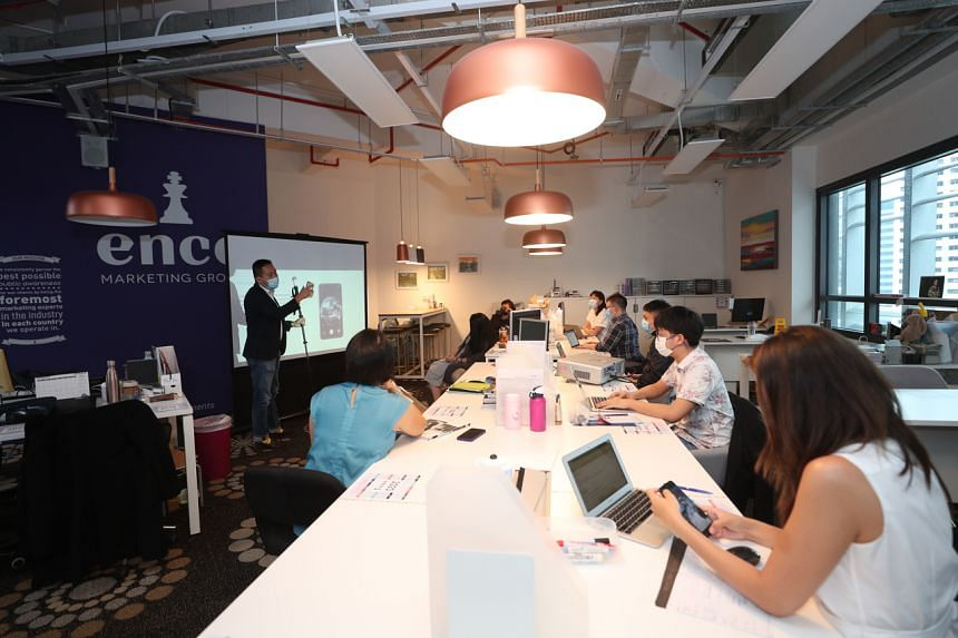 Staff from Ence Marketing Group at the company's headquarters in Raffles Place, on July 22, 2020.
