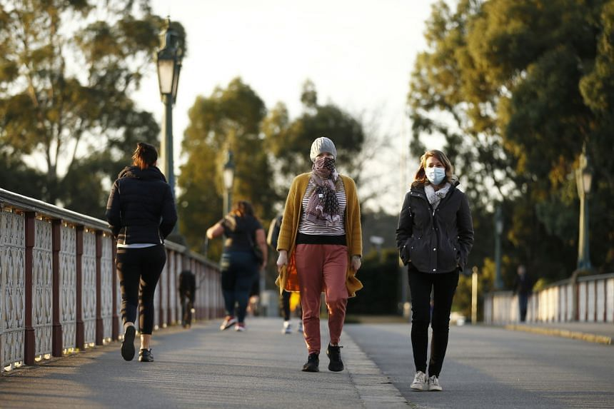 People along the Morell Bridge in Melbourne, on July 24, 2020.