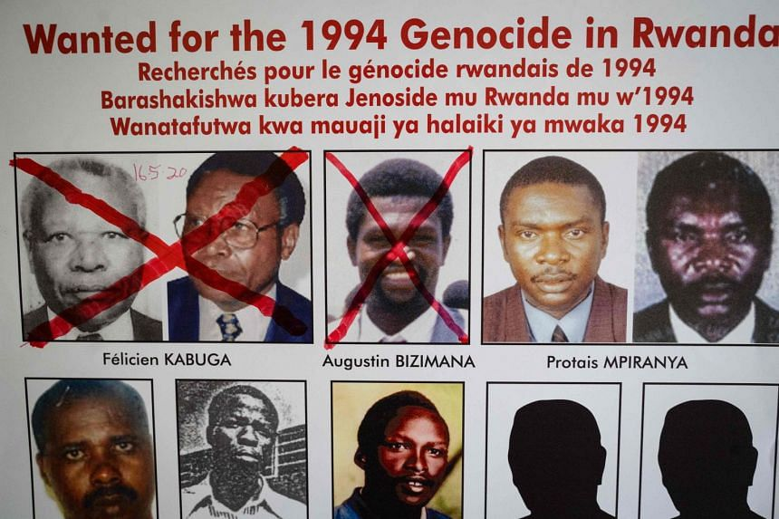 A wanted poster is seen at the Genocide Fugitive Tracking Unit office in Kigali, Rwanda, on May 22, 2020.