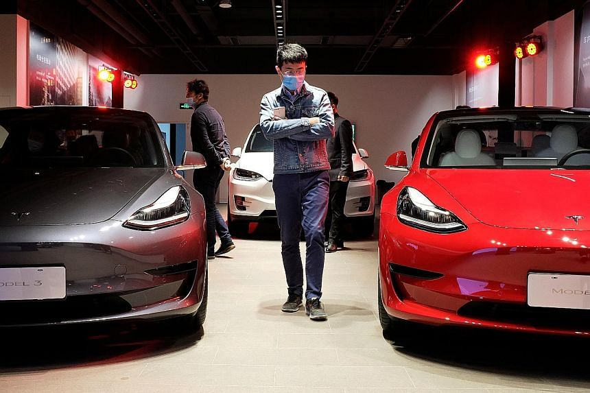 A Tesla showroom in Shanghai. Along with falling demand, the US firm presents a challenge for electric vehicle makers in China, prompting more start-ups to see initial public offerings as a way to ensure they stay in business.