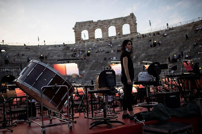 A musician during a rehearsal before a concert at the Arena in Verona, northern Italy, on Saturday. Italy was the first Western democracy to quarantine its entire population and it became one of the hardest hit in Europe by the coronavirus. A person