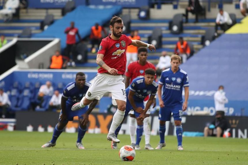 Manchester United midfielder Bruno Fernandes scores the opening goal against Leicester City.