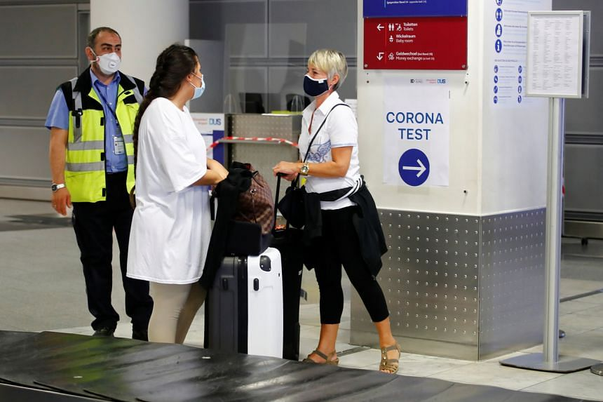 Travellers line up at the new Corona Test Centre at Duesseldorf Airport in Duesseldorf, Germany, on July 27, 2020.