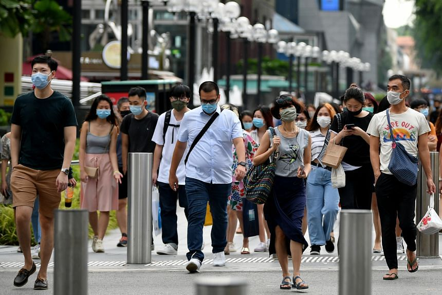 People walking along Orchard Road on June 19, 2020.