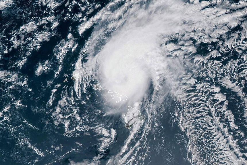 A satellite image showing Hurricane Douglas moving towards the west-north-west of Hawaii. If Douglas reaches the islands, it would be only the third hurricane in modern times to do so. The storm was expected to pass near the islands of Oahu and Kauai