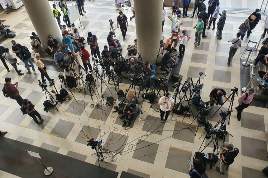 Media personnel gathered in the lobby of the court complex.