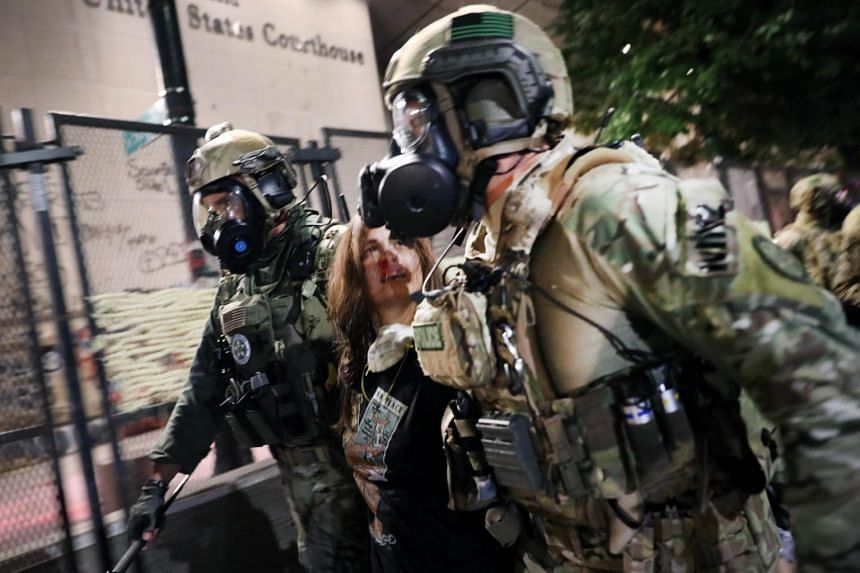 Federal police make an arrest as they confront protesters in Portland, Oregon, on July 26, 2020.