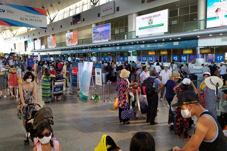 Tourists wait to check-in for departure at Da Nang Airport, Vietnam, on July 26, 2020.