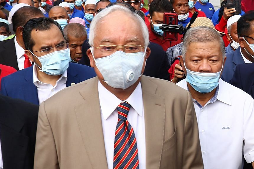 Former Malaysian prime minister Najib Razak arriving yesterday at the Kuala Lumpur High Court, where he was found guilty of seven charges, including abuse of power, and multiple counts of criminal breach of trust and money laundering for illegally re
