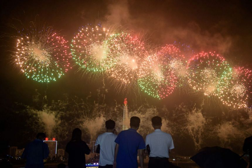People watching a fireworks display before the Juche Tower on Monday to mark the armistice that ended Korean War hostilities.