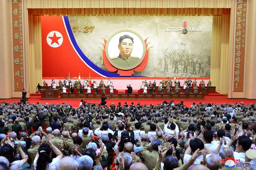 North Korean leader Kim Jong Un (centre) waving to attendees at the 6th National Conference of War Veterans in Pyongyang, during the 67th anniversary of the Korean War armistice on Monday. PHOTOS: AGENCE FRANCE-PRESSE
