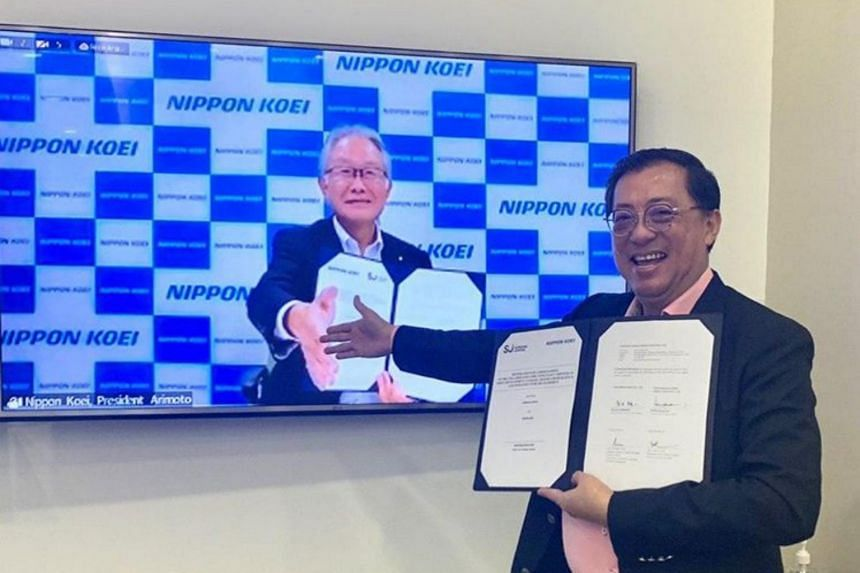 Surbana Jurong group chief executive Wong Heang Fine and Nippon Koei President Ryuichi Arimoto (screen).
