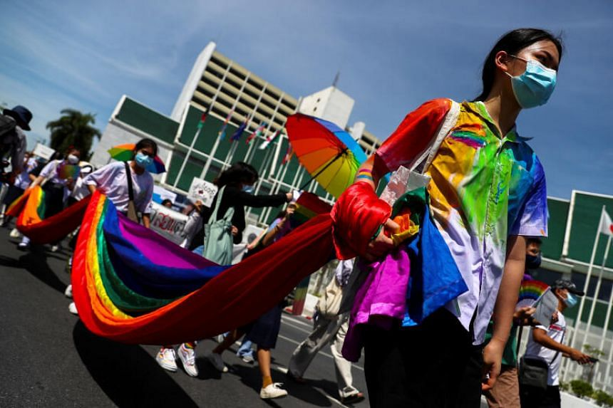 Students carry rainbow flags during a rally for gender rights in Bangkok on July 29, 2020.