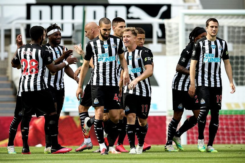 Newcastle players celebrate a goal against Liverpool on  July 26, 2020.