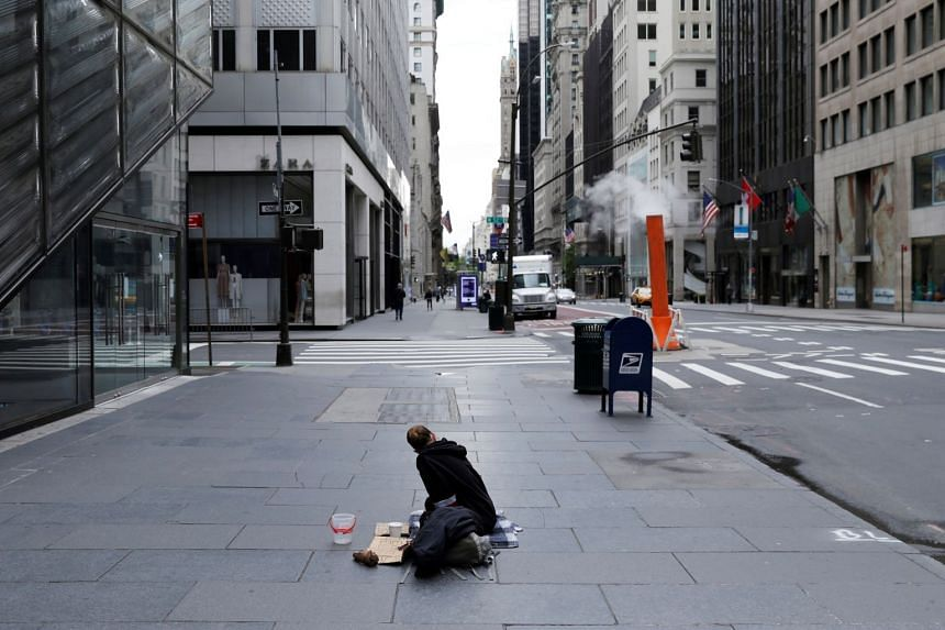 A May 2020 photo shows a homeless woman begging for money in coronavirus-hit New York City.