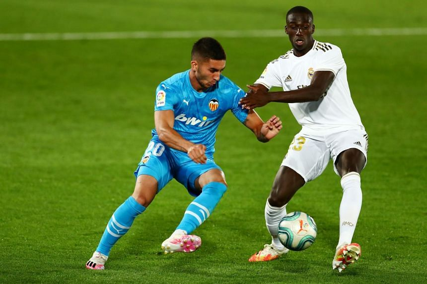 Valencia's Ferran Torres (left) vies with Real Madrid's Ferland Mendy.