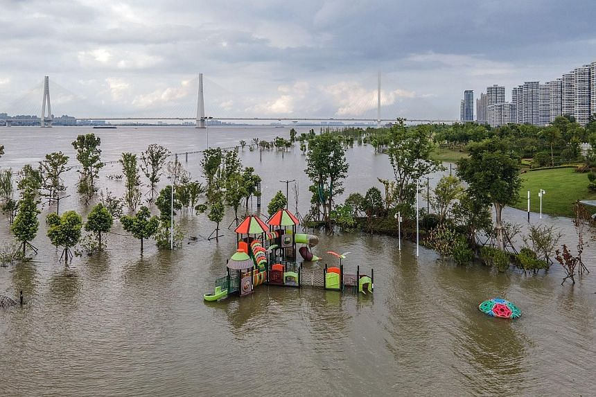 A flooded sports ground along the Yangtze River in Wuhan in China's central Hubei province. Floods in the country caused by continuous heavy rain since last month have affected some 54.8 million people in 27 provincial regions as of Tuesday, said the
