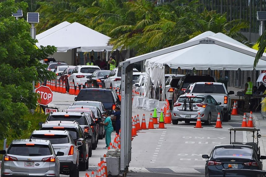 Cars line up for Covid-19 test at a testing site in Miami Beach on July 22, 2020.