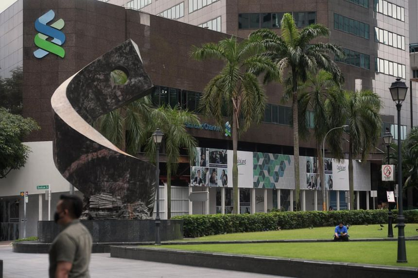 StanChart said it expected income to be lower in the second half, reversing its more optimistic note in April.