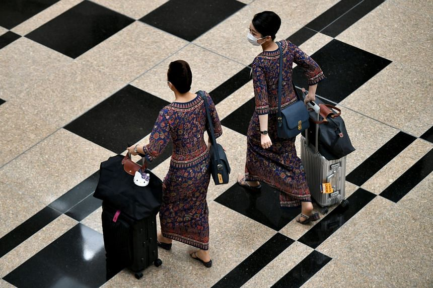 Singapore Airlines cabin crew in the transit area at Changi Airport Terminal 3 on June 12, 2020.
