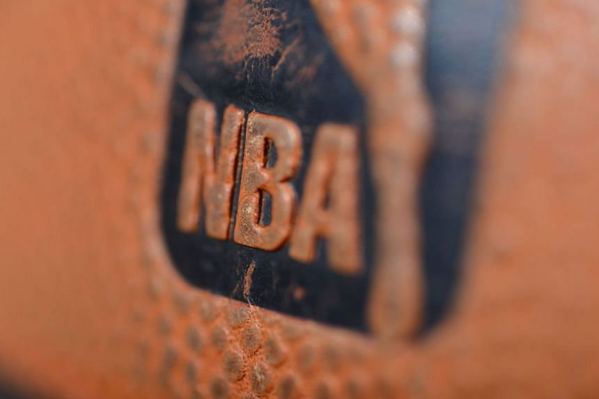 The NBA logo is seen on a ball prior to a game.