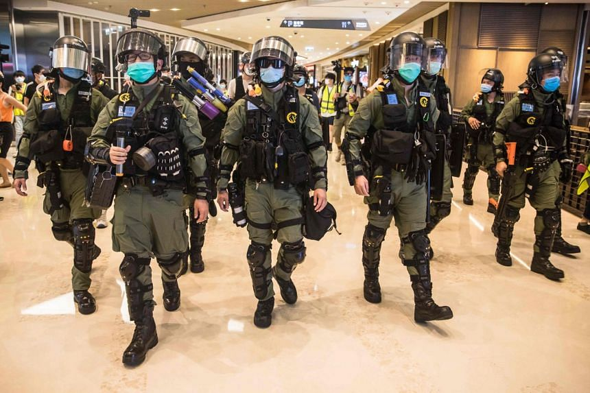 Hong Kong riot police secure a shopping mall after prostesters gathered on July 21, 2020.