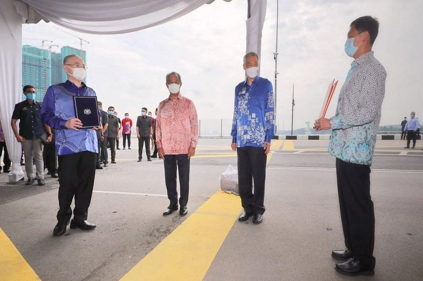 (From left) Malaysian Transport Minister Wee Ka Siong, Malaysian Prime Minister Muhyiddin Yassin, Prime Minister Lee Hsien Loong and Transport Minister Ong Ye Kung at the international boundary line on the Causeway on July 30, 2020.