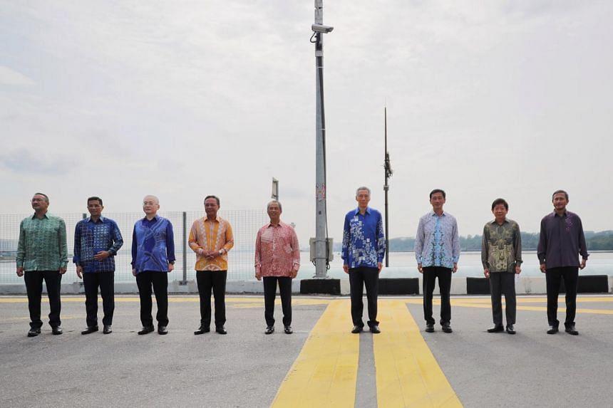 (From left) Malaysia's Foreign Minister Hishammuddin Hussein, Finance and Economics Senior Minister Azmin Ali, Transport Minister Wee Ka Siong, Johor Menteri Besar Haji Hasni bin Haji Mohammad, Malaysian PM Muhyiddin Yassin, Singapore PM Lee Hsien Lo
