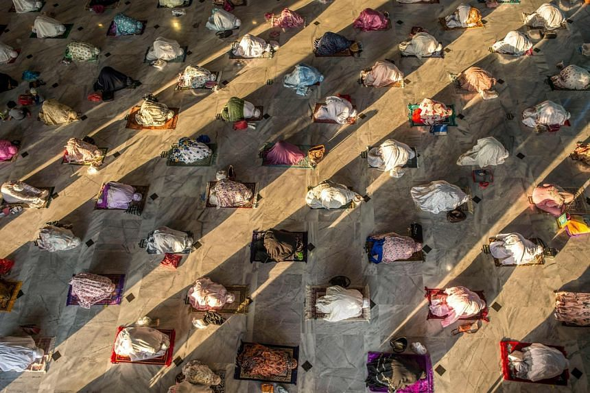 Muslims attend Eid al-Adha prayers with social distancing at a mosque in Surabaya, East Java, on July 31, 2020.