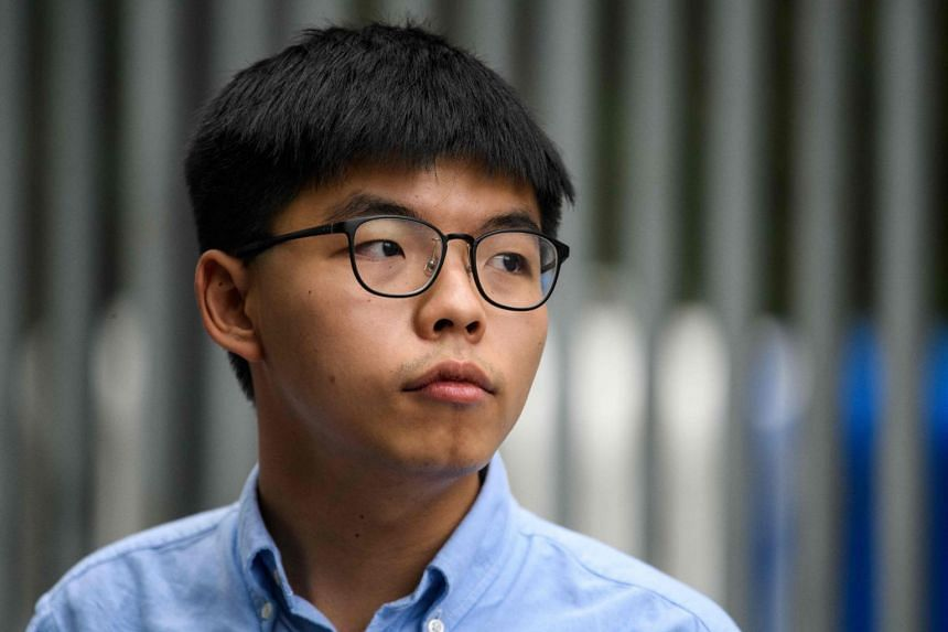 Pro-democracy activist Joshua Wong speaks to the media outside the Legislative Council in Hong Kong.on Oct 29, 2020.