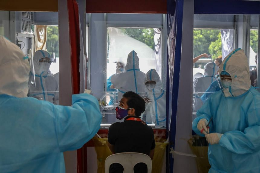Philippines extends coronavirus curbs as infections hit record for second day