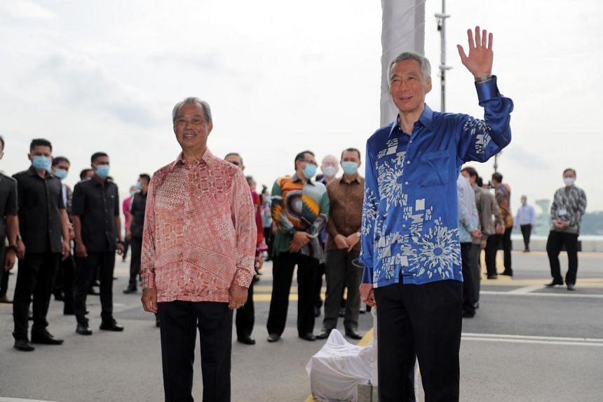 Malaysian PM Muhyiddin Yassin and PM Lee Hsien Loong at the Causeway, on July 30, 2020.