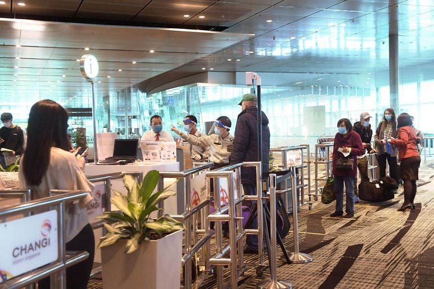Passengers being directed to the Transit Holding Area at Changi Airport Terminal 3 on June 23, 2020.