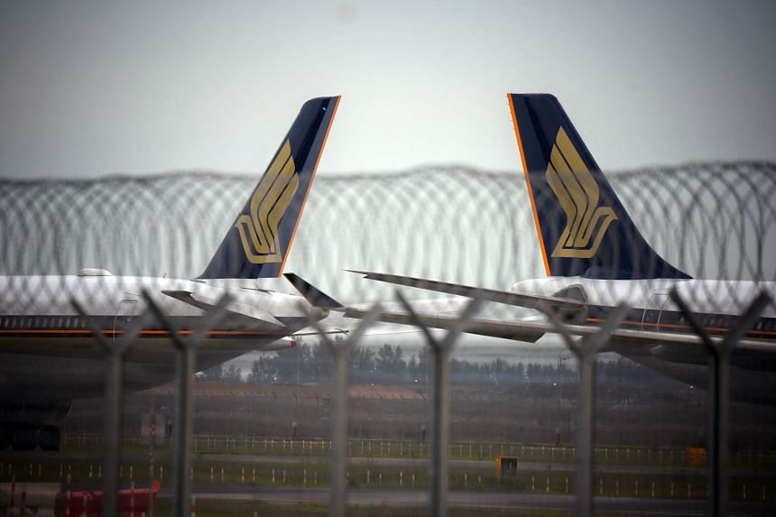 Singapore Airlines planes at Changi Airport last month. In his memo to staff, SIA chief executive Goh Choon Phong shared that industry experts now forecast it will take about two to four years for passenger traffic numbers to return to pre-pandemic l