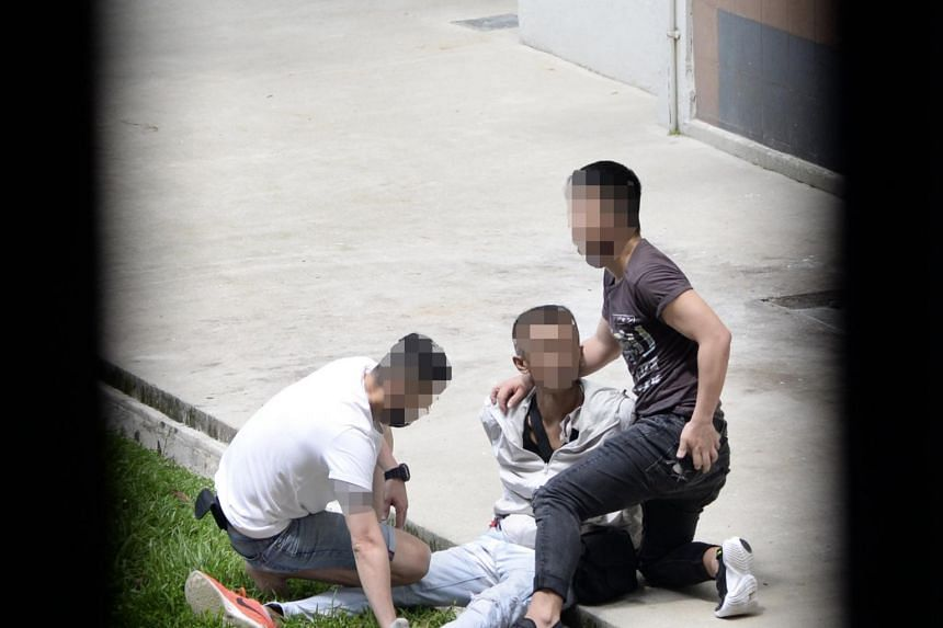 CNB officers arresting a man in Woodlands Street 13.