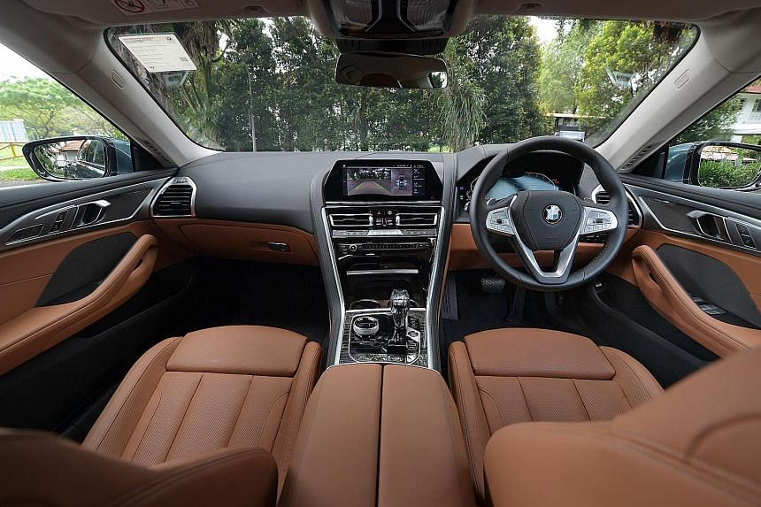The cabin of the BMW 840i Gran Coupe is immaculately finished with glass, veneer and leather. The BMW 840i Gran Coupe, measuring 5,082mm by 1,932mm by 1,407mm tall, exudes a commanding presence.