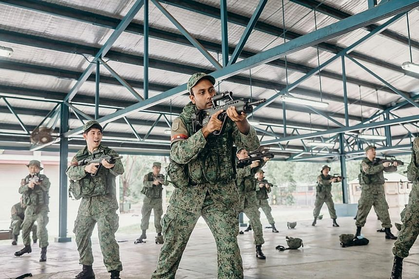 Operationally ready national servicemen from the 735th Battalion Singapore Guards going through pre-deployment training last month that included refresher courses on search-and-arrest techniques and engaging hostile individuals, as well as firing exe