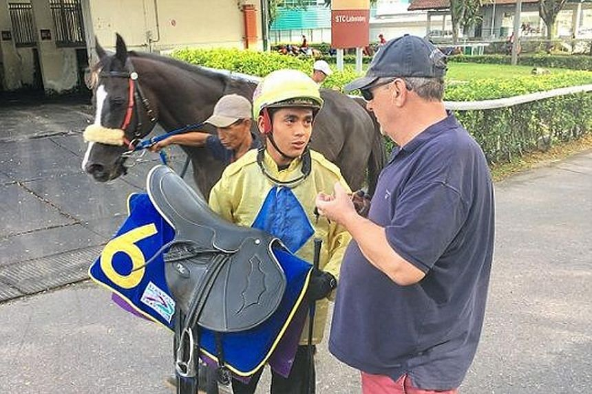 Apprentice jockey Iskandar Rosman with his master, trainer Lee Freedman, before the Covid-19 pandemic.