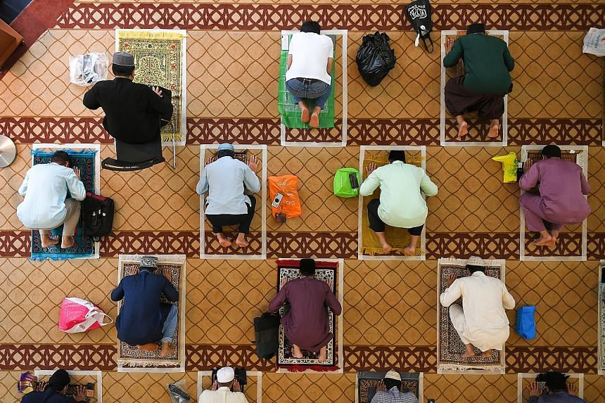 Worshippers at Masjid Maarof in Jurong West yesterday. Most mosques held three sessions with no more than 50 worshippers - who had to book slots online - each time. ST PHOTO: SHINTARO TAY