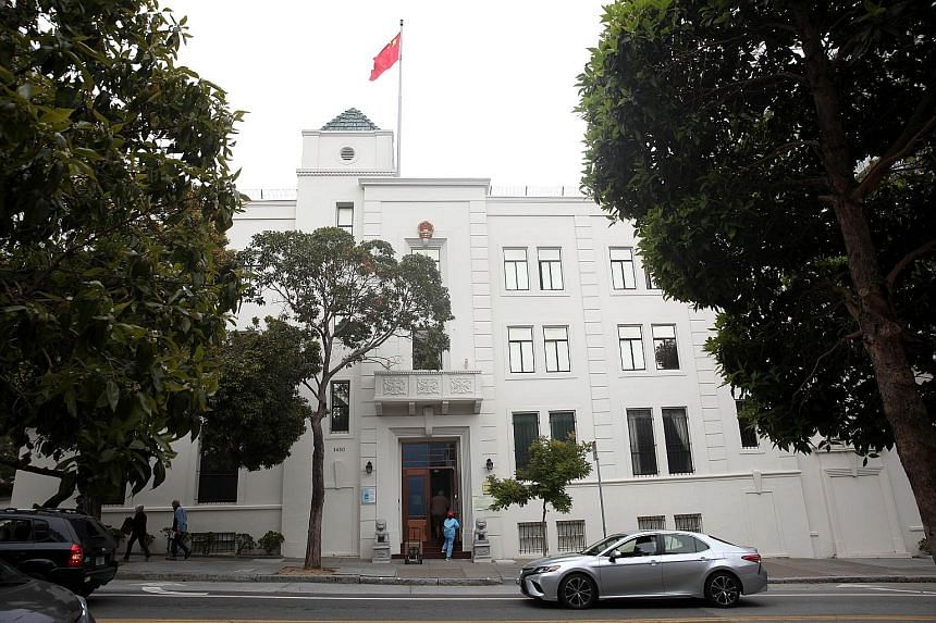 Researcher Juan Tang (above) had retreated to the Chinese consulate in San Francisco (left) for a month. She was arrested after leaving it to get medical attention. PHOTO: AGENCE FRANCE-PRESSE: