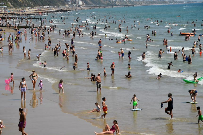 People escape the heatwave at Bournemouth Beach, Britain, on July 31, 2020.