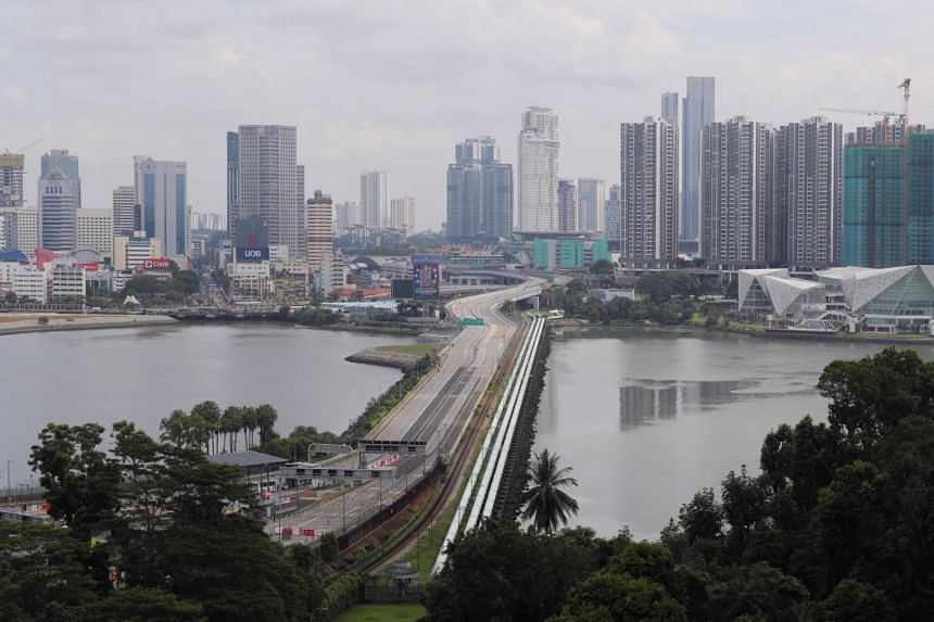 The empty Causeway as seen from a HDB flat in Marsiling on July 26, 2020.